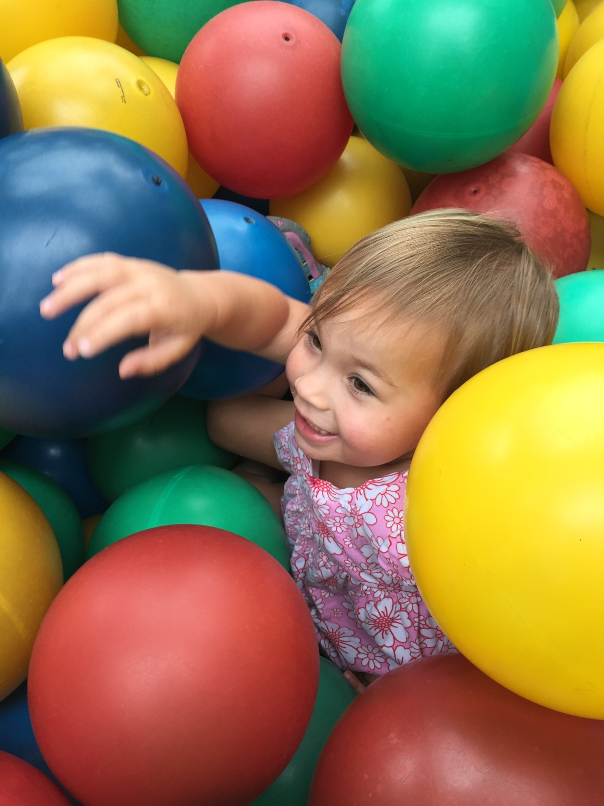 Adorable baby in a ballpit